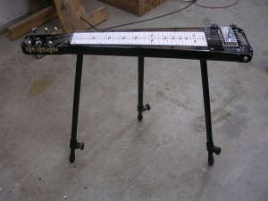 """Rogue"" brand lap steel with legs"